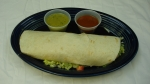 Burrito Degollado - The best California-style burrito filled with your choice of grilled chicken or steak, rice, beans, lettuce, sour cream, cheese and pico de gallo. Served with burrito sauce on the side.